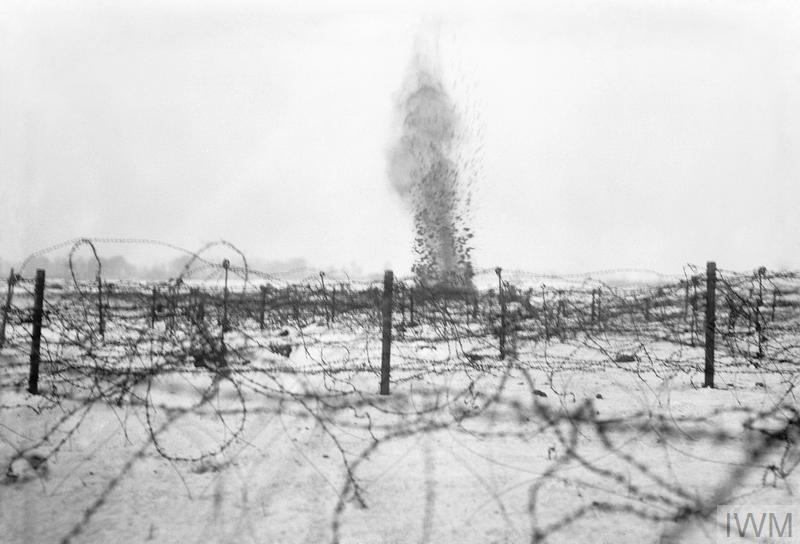 A shell bursting amongst the barbed wire entanglements on the battlefield at Beaumont Hamel,